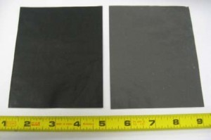 "Figure 1. Two 4""x5"" samples of paper-like nanocarbon sheet (left: 2-FC-50, right: 2-MD-53) created through our NanotoMacro™ manufacturing process."